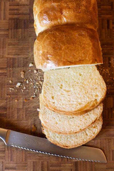 Brioche loaf cut brumb bread knife
